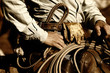 Real working cowboy riding in sunset light (sepia tint)