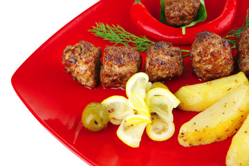 roast cutlets on red dish