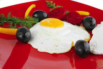 egg served on red dish