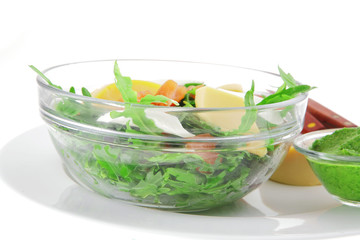 salad with smoked salmon in transparent bowl