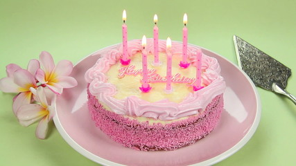 Lighting the pink candles on the birthday cake.