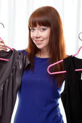 woman finding clothes at store