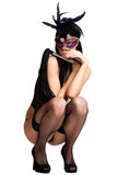 sexy girl in lingerie with a mask on her face and a whip