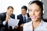Portrait of happy smiling upport phone operator at workplace