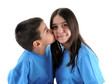 Cute boy kissing his sister isolated on white background.