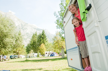 Little girl with mother in camper