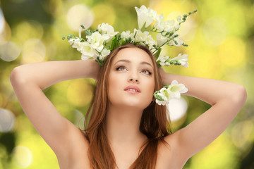 naked woman isolated on green background with flowers