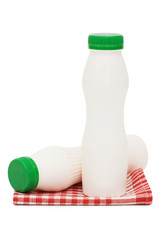 Yoghurt in a bottle on a red napkin