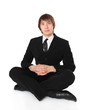 Businessman sitting on the floor and meditating