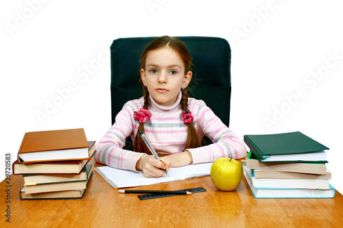 girl being at a writing table with books