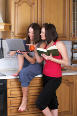 Two beautiful women trying to cook something