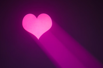 valentine heart projected with purple spotlight