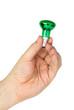 Hand hold tiny green spot tungsten lightbulb