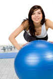 Woman doing fitness exercise with fitness ball