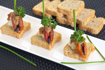 Appetizer with mussels, decorated with parsley