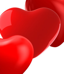 close up of bright red hearts on white background