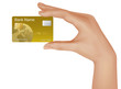 Gold credit card in hand . Vector