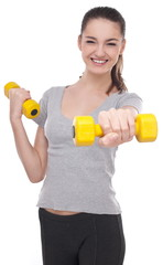 Young girl lifting barbells on a white background