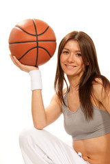 Pretty brunette woman holding Basketball in hand