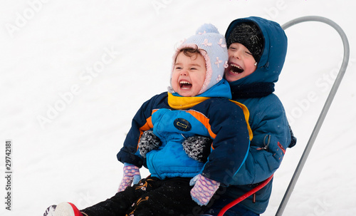 children on sleds