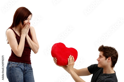 young couple beauty with a heart (white background)