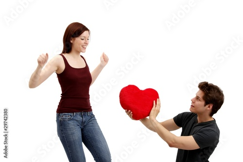 young couple beauty with a heart (movement - white background)