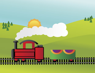 toy train steaming through the countryside