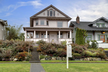 Victorian house  with large covered porch for sale