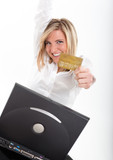 Thrilled young woman with  credit card and laptop poster
