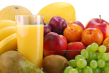 Variety of fruits and glass of orange juice