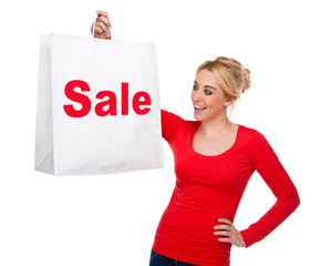 Sale Shopping - Beautiful Woman Displaying Sale Bag