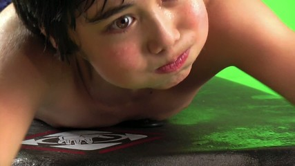 boy swimming on bodyboard