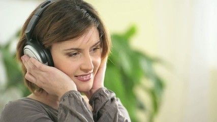 Happy woman listening to music; HD 720, H 264