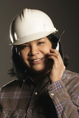 Female Site Worker On Cell Phone