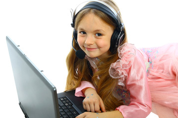 little girl with laptop and headphones isolated on white