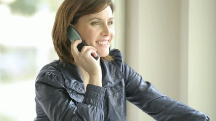 Beautiful woman speaking on the phone; HD 720, H 264