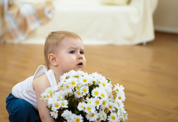 a little boy with white flowers