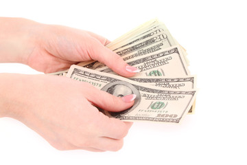 American dollars in a hand on a white background