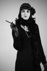 Retro fashion portrait of woman. 1920s stylization.
