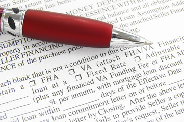 closeup of a mortgage application and pen