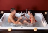 Couple celebrating in jacuzzi