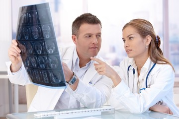 Male and female doctors consulting in office