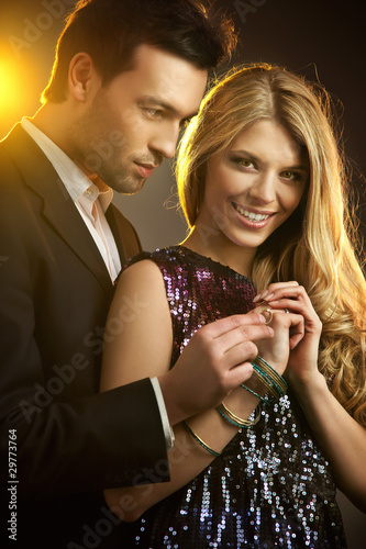 Happy young man gifting a ring to a beautiful young woman