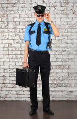 Policeman with case