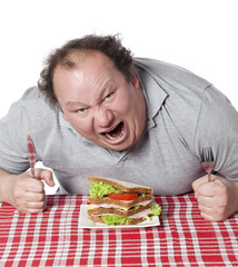 homme obèse dévorant un sandwich