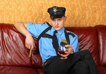 The policeman with Cigar and cognac