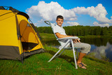 man at the campsite poster