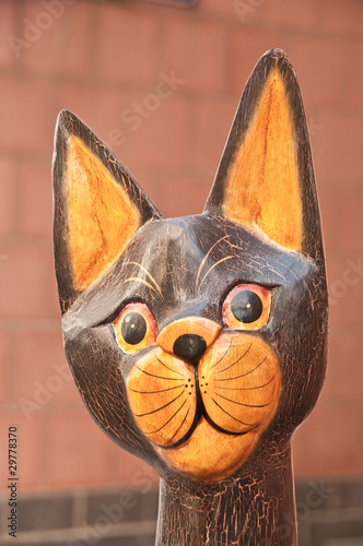 Portrait of wooden hand painted cat statuette