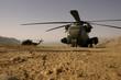 Leinwanddruck Bild - Hubschrauber im Staub