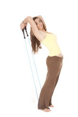 Woman leaning back pulling jump rope